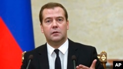FILE - Russian Premier Dmitry Medvedev.