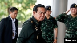 FILE - Thai Army chief General Prayuth Chan-Ocha arrives before a meeting to discuss the 2015 national budget at the Army Club in Bangkok, June 13, 2014.