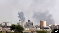 FILE - Smoke rises after an airstrike by the Saudi-led coalition in Sanaa, Yemen, Sept. 6, 2015.
