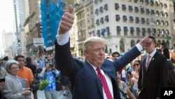 "FILE - In this Sept. 24, 2015, file photo, Republican presidential candidate Donald Trump waves to the crowd gathered in front of Trump Tower ahead of the arrival of the pope's motorcade for an appearance in New York's Central Park. Trump holds a trademark to use the words ""Central Park"" on items including furniture, chandeliers and even key chains."