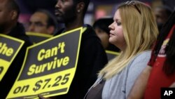 FILE - U.S. workers participates in a rally in support of raising the minimum wage University City, Missouri.