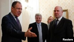 Russian Foreign Minister Sergei Lavrov (L) welcomes Nils Muiznieks (R), human rights commissioner for the Council of Europe, for talks in Moscow, April 2013.