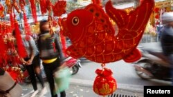 """Fish-shaped decoration items are displayed for sale for 'Tet"""" in Hanoi, Jan. 21, 2014."""