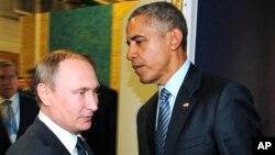 바락 오바마 미국 대통령(오른쪽)과 블라디미르 푸틴 러시아 대통령이 30일 유엔 기후변화협약 당사국쵱회가 열린 프랑스 파리에서 만났다.