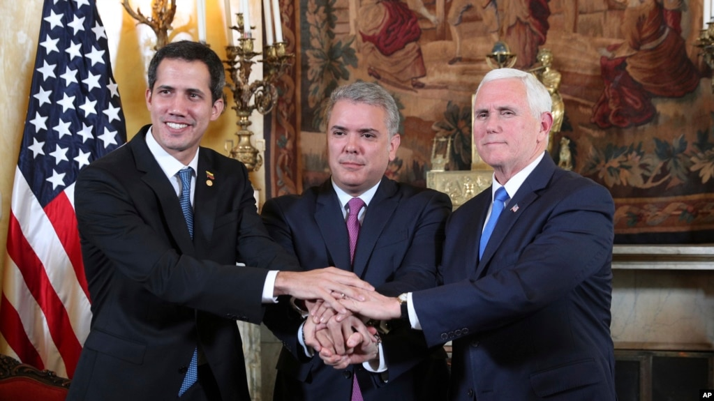 Venezuela's self-proclaimed interim president Juan Guaido, Colombia's President Ivan Duque and Vice President Mike Pence, pose for a photo after a meeting of the Lima Group concerning Venezuela at the Foreign Ministry in Bogota, Colombia, Monday, Feb. 25, 2019.