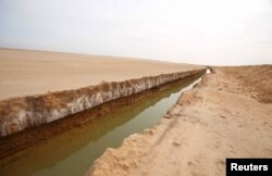 FILE - A general view of a trench that forms part of a barrier along the frontier with Libya is seen in Sabkeht Alyun, Tunisia, Feb. 6, 2016.
