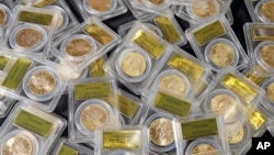 FILE: Some of 1,427 Gold-Rush era U.S. gold coins are displayed at Professional Coin Grading Service in Santa Ana, Calif., Tuesday, Feb. 25, 2014.