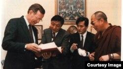 FILE - President George H.W. Bush with Lodi Gyari, Tenzing N. Tethong and His Holiness the Dalai Lama in 1991.