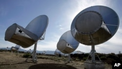 FILE - Radio telescopes of the Allen Telescope Array are seen in Hat Creek, Calif.