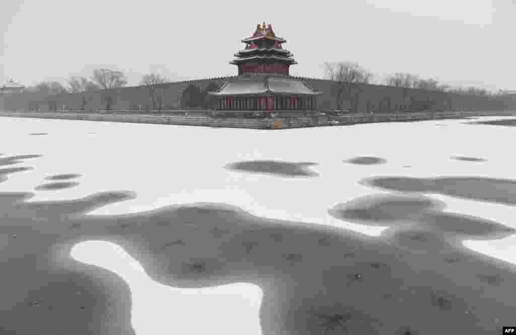 Snow is seen in the moat surrounding the Forbidden City during a snowfall in Beijing, China.