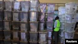 An IEBC official inspects ballot boxes at Kasarani gymnasium, Nairobi, March 5, 2013.