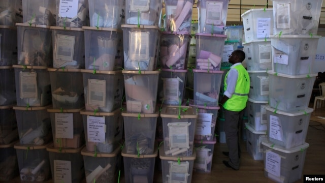 An IEBC official inspects ballot boxes at Kasarani gymnasium, Nairobi, March 5, 2013.
