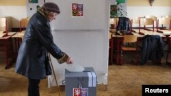 A woman casts her ballot during the country's first-ever direct presidential election to replace the outgoing president Vaclav Klaus, in Prague January 11, 2013.