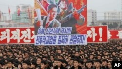 North Koreans gather during a mass rally to vow to carry through the tasks set forth by North Korean leader Kim Jong Un in his New Year's address, at Kim Il Sung Square in Pyongyang, North Korea, Jan. 5, 2017.