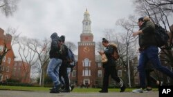 FILE - Brooklyn College students walk between classes on campus in Brooklyn, New York, Feb. 1, 2017.