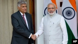 Sri Lankan Prime Minister Ranil Wickremesinghe, left and Indian Prime Minister Narendra Modi pose for the media before their talks in New Delhi, India, Sept. 15, 2015.