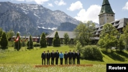Leaders of the Group of Seven (G7) nations and the EU take part in a family photo at the G7 Summit in Kruen, Germany, June 7, 2015.