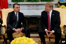 President Donald Trump speaks during a meeting with Brazilian President Jair Bolsonaro in the Oval Office of the White House, March 19, 2019, in Washington.