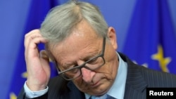 "FILE - European Commission President Jean-Claude Juncker, pictured at a Brussels news conference in July, says the EU will lose ""all kinds of credibility"" if aid pledges to help with the migrant crisis aren't met."