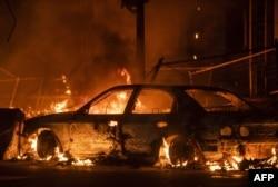 A car burns near the Third Police Precinct on May 27, 2020 in Minneapolis, Minnesota.