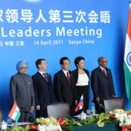 India's Prime Minister Manmohan Singh, Russia's President Dmitry Medvedev, China's President Hu Jintao, Brazil's President Dilma Rousseff and South Africa's President Jacob Zuma (L-R) pose during the BRICS (Brazil, Russia, India, China and South Africa) s