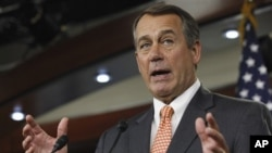 House Speaker John Boehner of Ohio gestures during a news conference on Capitol Hill in Washington, Feb. 17, 2011.