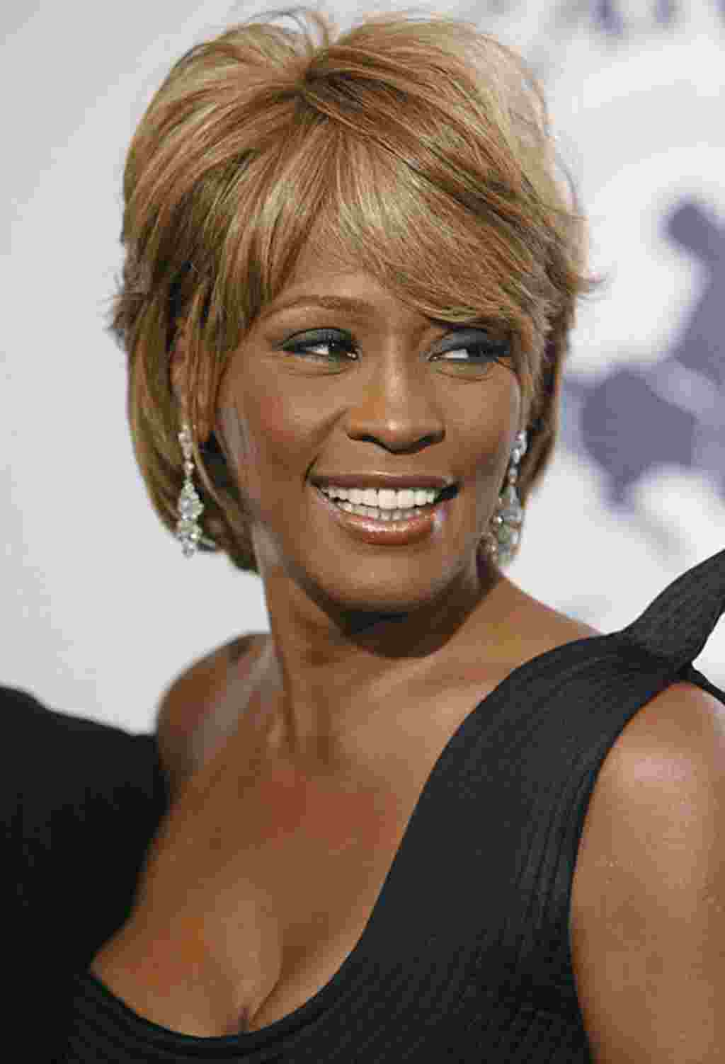 In this Oct.ober 28, 2006 photo, Whitney Houston arrives at the 17th Carousel of Hope Ball in Beverly Hills, California. Houston died February 11, 2012. (AP)