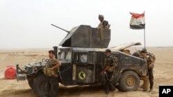 Quân tiếp viện cho lực lượng chống khủng bố Iraq đến sân vận động Ramadi sau khi lấy lại quyền kiểm soát khu phức hợp và các khu vực lân cận al-Bugleeb, ngày 6/10/2015.