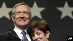 Sen. Harry Reid, D-Nev., embraces his wife Landra during the Nevada State Democratic election night party after defeating Sharron Angle to win re-election, 2 Nov. 2010, in Las Vegas.