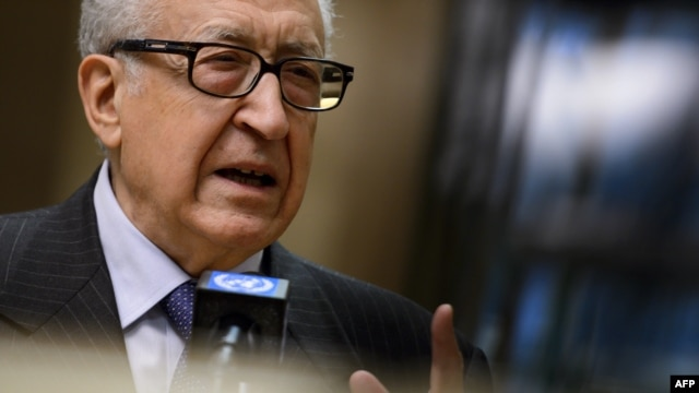 UN-Arab League peace envoy Lakhdar Brahimi gestures during a stakeout following a meeting with top US and Russian officials on the Syrian conflict at the United Nations office in Geneva, January 11, 2013.