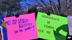 Protesters, like here at a recent rally outside the White House, have called for a new vote in the Democratic Republic of Congo.