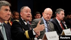 NSA Director General Keith Alexander (2nd L) testifies on Capitol Hill in Washington October 29, 2013.