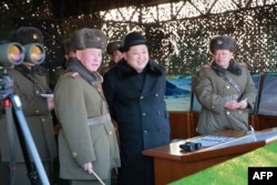 Undated photo released by North Korea's official Korean Central News Agency (KCNA) on Feb. 21, 2016 shows North Korean leader Kim Jong-Un, center, inspecting maneuvers for attack and defense between large combined units of the Korean People's Army (KPA).