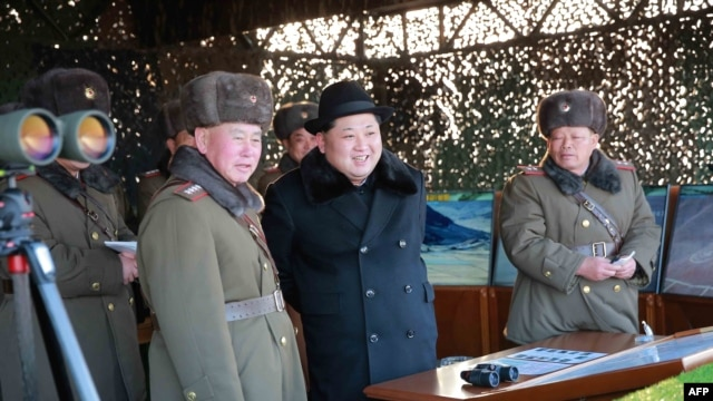 FILE - Undated photo released by North Korea's official Korean Central News Agency (KCNA) on Feb. 21, 2016 shows North Korean leader Kim Jong-Un (C) inspecting maneuvers for attack and defense between large combined units of the Korean People's Army (KPA).
