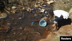Residences of Mabvuku fetch water from unprotected sources in Harare, Zimbabwe, July 28, 2012.