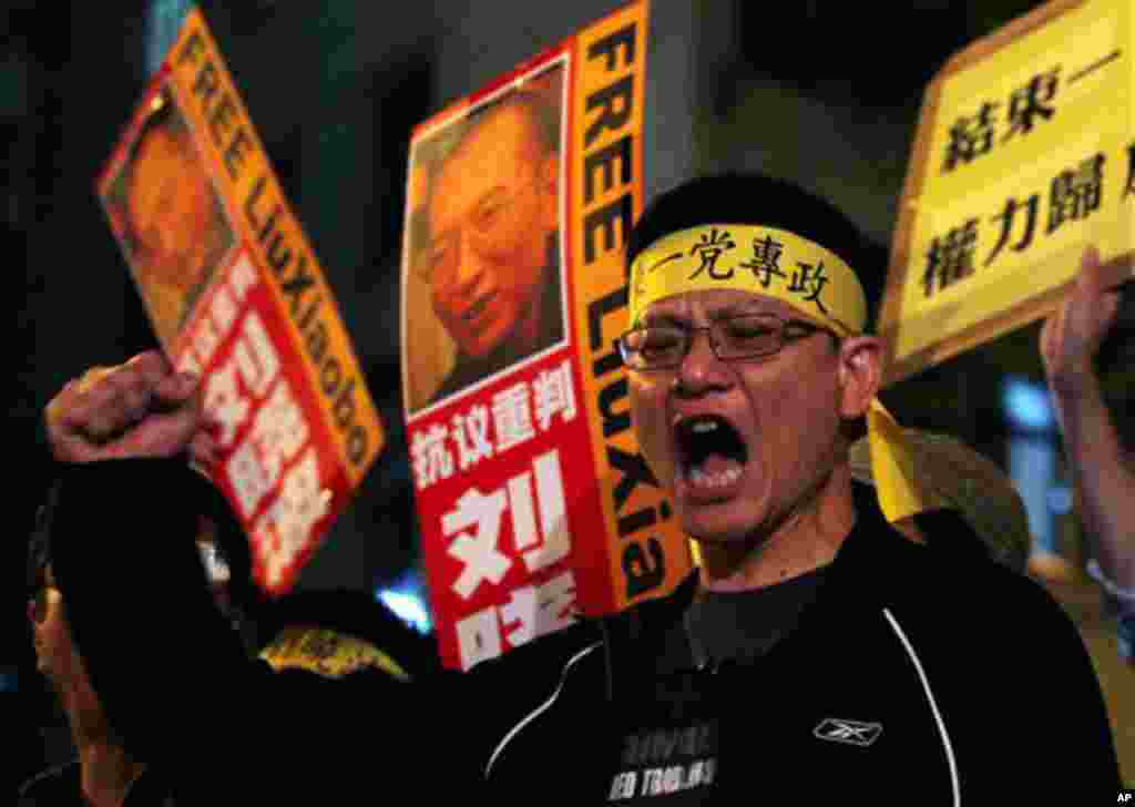Pro-democracy protesters hold the picture of Chinese dissident Liu Xiaobo during a demonstration outside the China's Liaison Office in Hong Kong Friday, Oct. 8, 2010. Imprisoned Chinese dissident Liu Xiaobo won the 2010 Nobel Peace Prize on Friday for usi