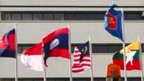 FILE - In this April 22, 2021, photo, flags of some of the ASEAN member countries fly at the ASEAN Secretariat in Jakarta, Indonesia.