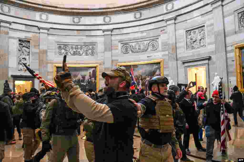 Supporters of US President Donald Trump enter the US Capitol's Rotunda
