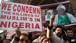 FILE - Kashmiri Shiite Muslims shout slogans against the Nigerian government in Srinagar, Indian-controlled Kashmir, Dec. 18, 2015