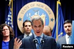 FILE - New York Attorney General Eric Schneiderman speaks in New York, June 28, 2016.