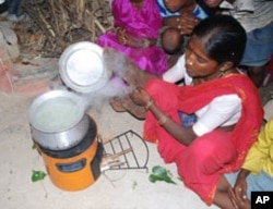 This woman in India uses a cookstove developed by Willson's team that produces less smoke for burning wood or any other fuel.