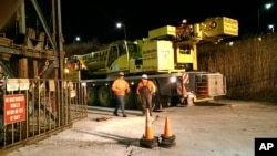 This photo provided by the Ithaca Fire Department shows a crane that was to assist in the rescue of 17 miners stuck in an elevator underground at the Cargill Salt Mine in Lansing, New York, Jan. 7, 2016.