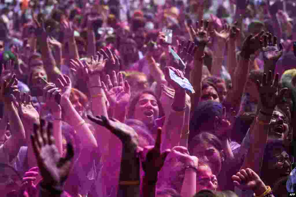 People gdance as they take part in the Color Festival at Kadikoy district in Istanbul, Turkey.