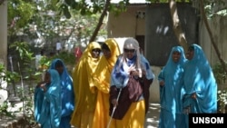 The Somali government identified the woman in the center of this 2018 UNSOM photo as the suicide bomber who killed eight people, including Mogadishu Mayor Abdirahman Omar Osman, in a July 24, 2019, attack.