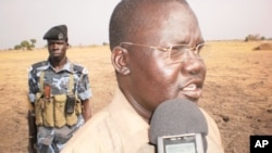 Guit County Commissioner of Unity State in South Sudan, James Puoy Yaka, talks to the press in Thaon village, April 12, 2012.