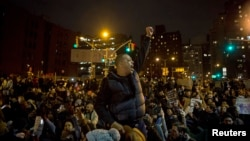 Protesters gather in Manhattan as thousands take to the streets of New York demanding justice for the death of Eric Garner, Dec. 5, 2014.