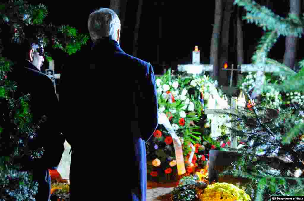U.S. Secretary of State John Kerry chats with Michal Mazowiecki, the son of former Polish Prime Minister Tadeusz Mazowiecki, after paying his respects at the father's gravesite in Laski Cemetery outside Warsaw, Poland, on November 4, 2013.