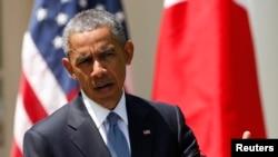 美國總統奧巴馬星期二在聯合記者會上說,中國在南中國海的行為是美國和日本共同感到擔憂的問題。(路透社)