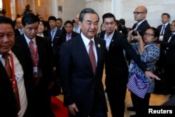China's Foreign Minister Wang Yi arrives at a meeting at the sidelines of the ASEAN foreign ministers meeting in Vientiane, Laos July 25, 2016.