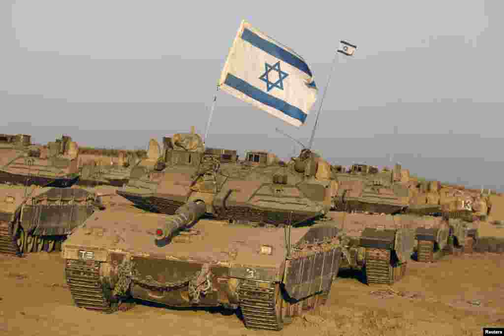 Israeli tanks are seen in a staging area near the border with the Gaza Strip, Aug. 7, 2014.